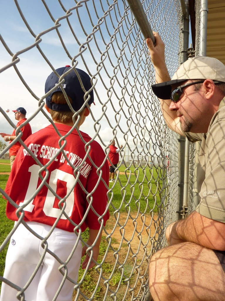 Jeremy watching his son play baseball.